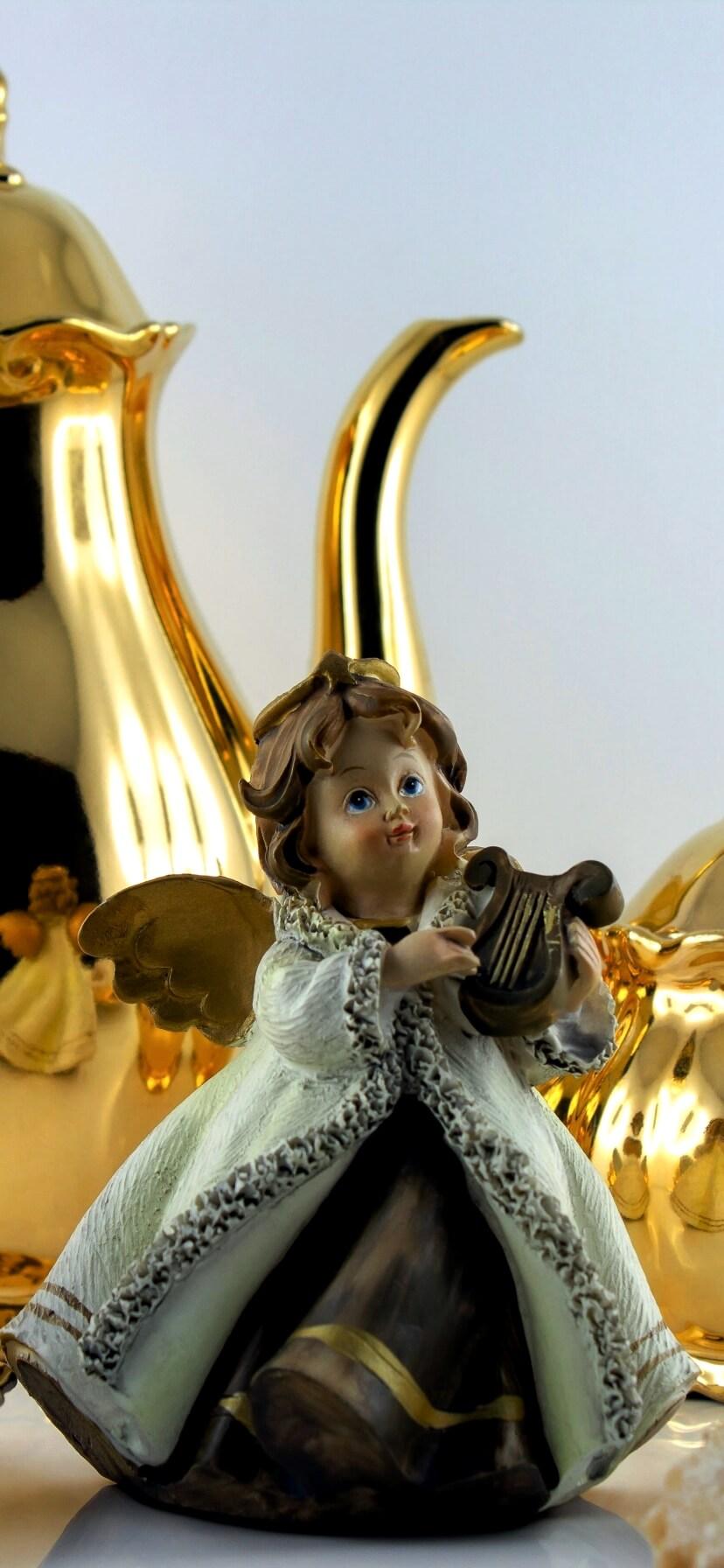 金色のポットと天使