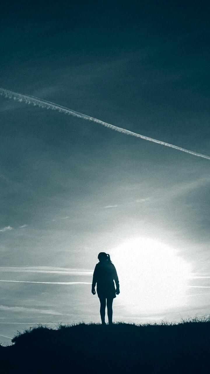 飛行機雲と女の子